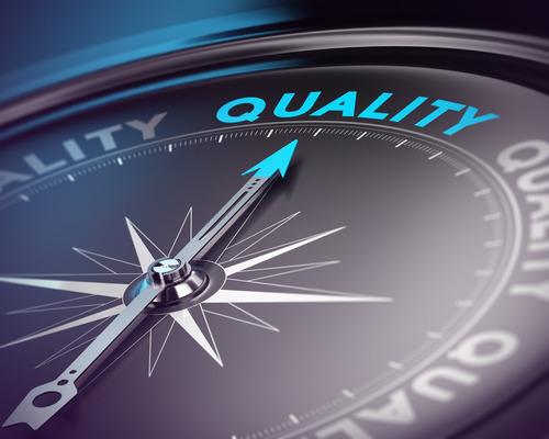Photo of a time clock pointing to target top quality management standards